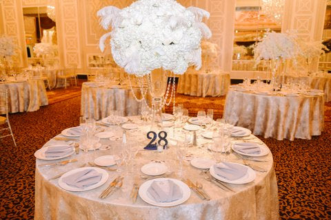 Tall Wedding Centerpieces with feathers Anissa Rae Flowers NYC