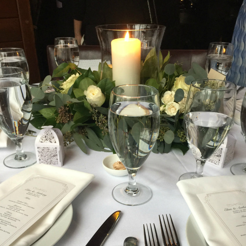 Rustic Eucalyptus Centerpiece with Pillar Candles NYC Floral Designer Anissa Rae Flowers