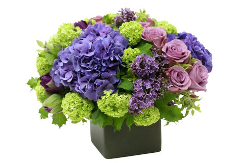 Flower Arrangement with sweet smelling stems of lilac for NYC delivery