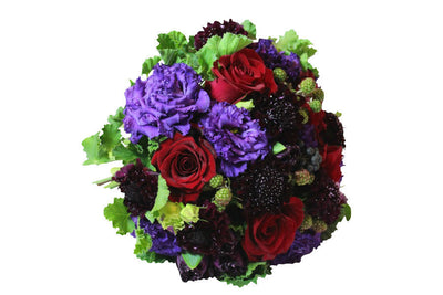 Hand-tied bouquet in purple and red flowers