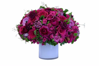 Pink Flowers in white vase for delivery in NYC