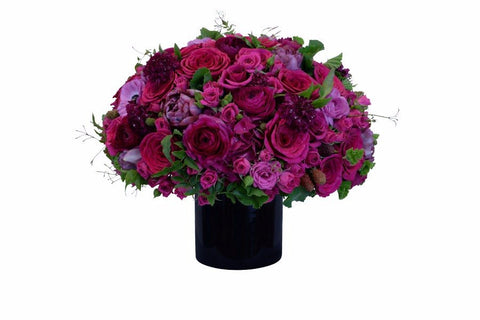 Shades of pink fresh cut flower vase arrangement