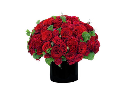 Fresh cut flower vase arrangement in red hues.