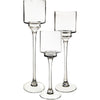 Set of 3 stemmed glass candle holders.