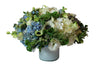 Blue Flowers with touches of white and green vase arrangement.