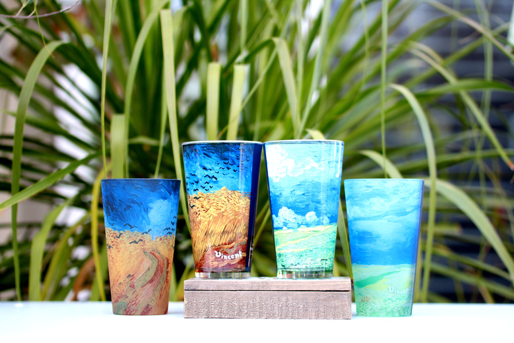 Four Van Gogh pint glasses featuring Wheatfield with Crows and Wheatfield Under Thunderclouds