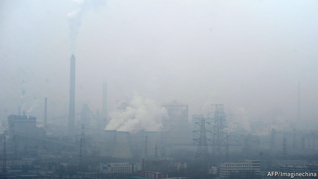 Air pollution in China with smokestacks and hazy air