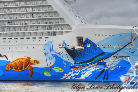 Guy Harvey paints the hull of the Norwegian Escape cruise ship