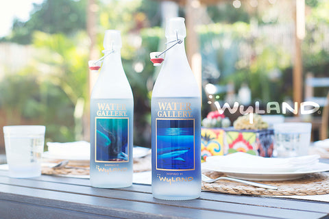 Water Gallery bottles at a gorgeous outdoor dining table
