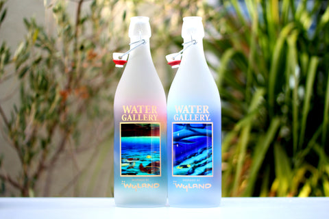 Beautiful glass water bottles featuring Wyland art