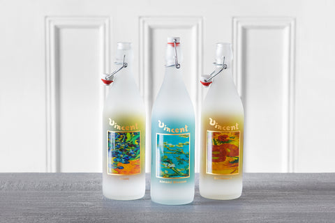 Van Gogh bottles featuring Irises, Almond Blossom, and Sunflowers