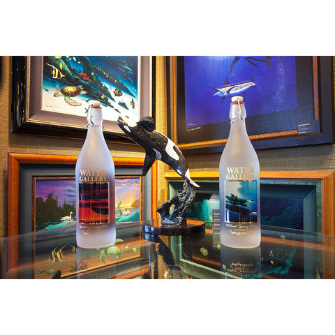 Next, the Orca Trio bottles literally shining in the sun against the aquamarine ocean and blue sky: