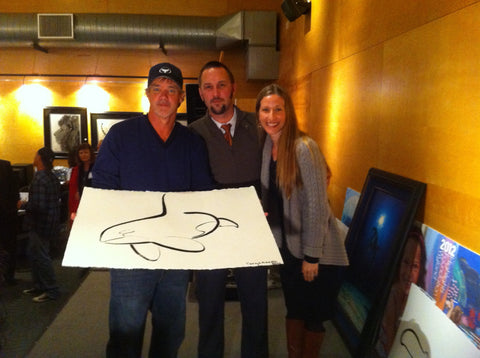 Gallery Drinkware Founders Kenny and Leah Laskan pose with Wyland and his incredible brush art