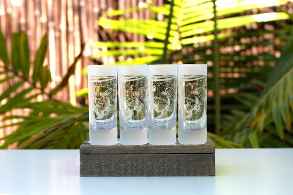 Four Wyland turtle double shot glasses