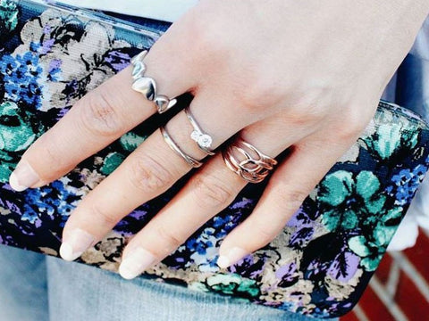 woman wearing multiple fashion rings