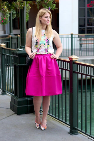 woman in a pink skirt