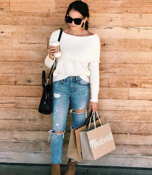 woman in white sweater and jeans