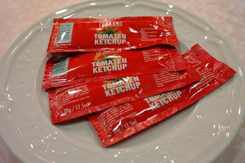 ketchup packets on a small plate