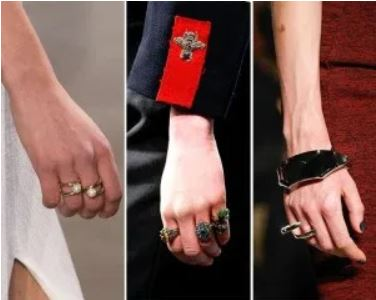 hands of models wearing multiple rings