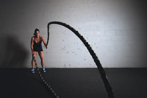woman exercising with rope