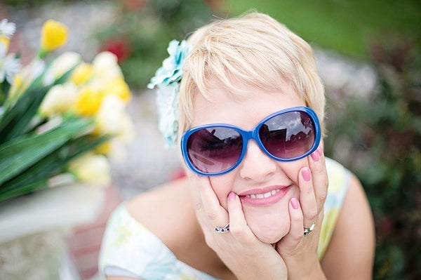 woman wearing vintage style sunglasses