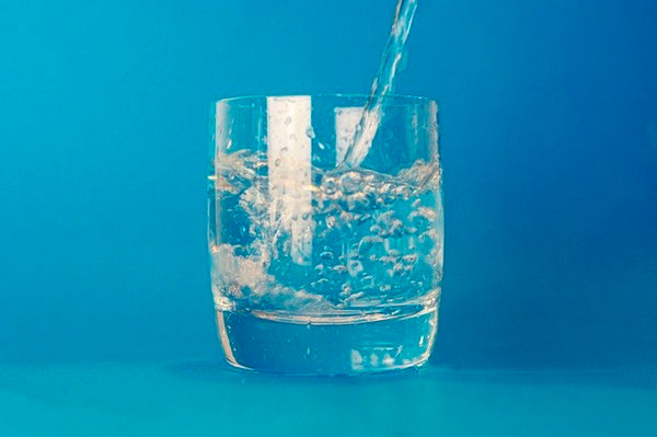 glass of water against blue background