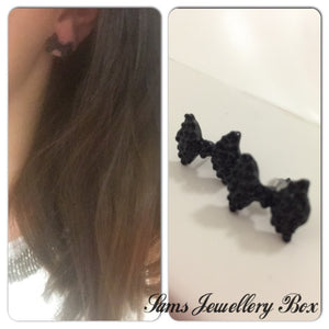 Black bow stud earrings