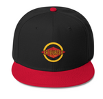 Image of a black with red brim fatburger snapback with the logo embroidered.
