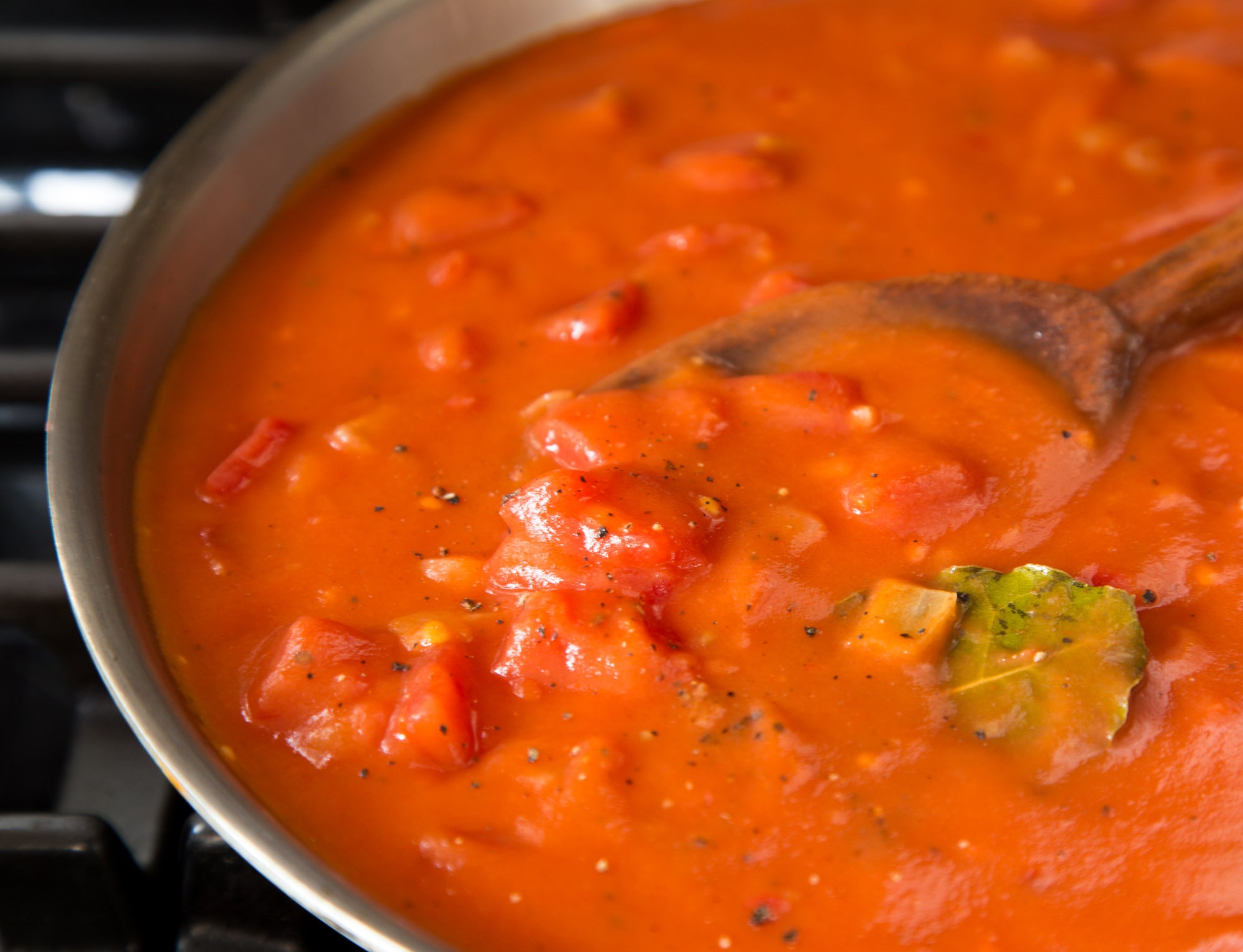 classic-southern-tomato-gravy-cooking-in-skillet-bay-leaves