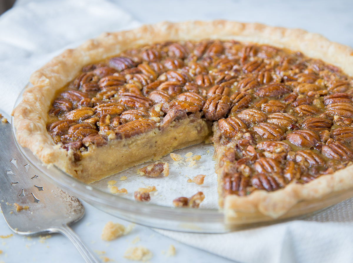sliced-stone-ground-heirloom-grits-pecan-pie-with-knife-and-pie-server