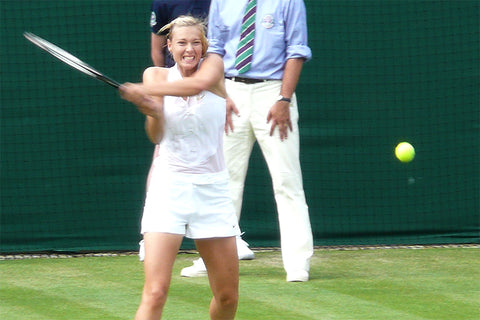 Maria Sharapova in action against Stéphanie Foretz in the first round of the 2008 Wimbledon Championships