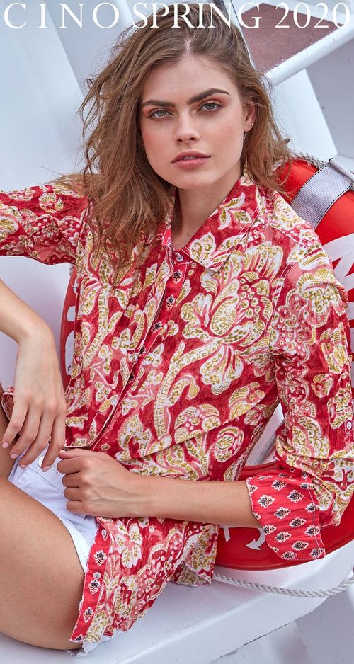 A model wears a CINO Martinique Coral button-down shirt.