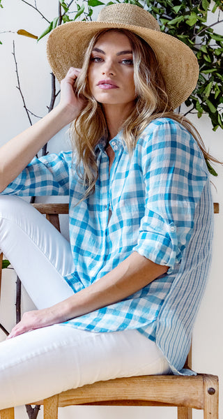 A model wears a CINO Check Vintage Turquoise button-down relaxed shirt.