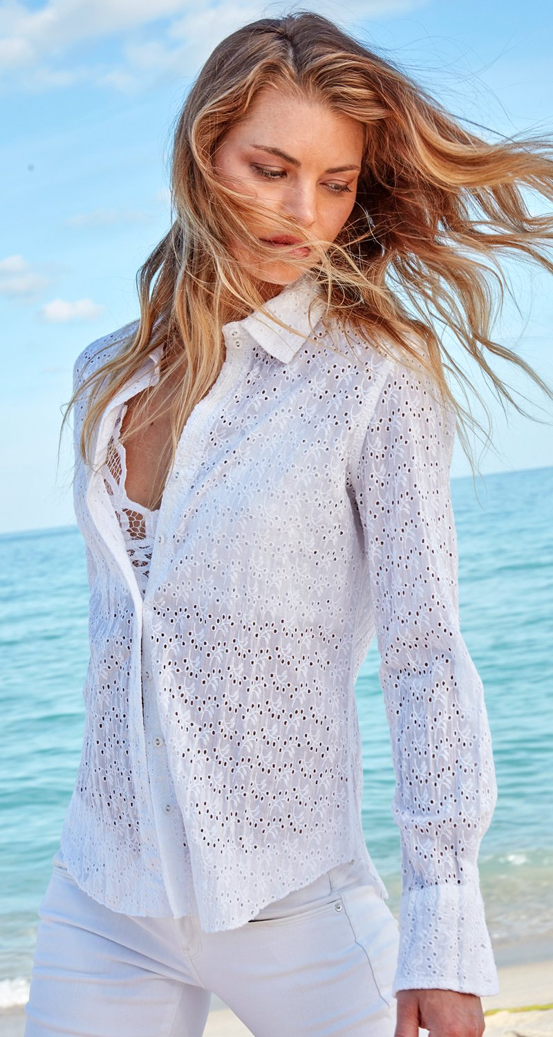 A model wears a CINO Tossed Eyelet White button down shirt.