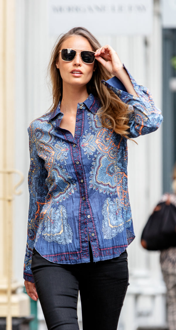 A model wears a CINO Angelina Paisley DK Vintage Blue button-down shirt