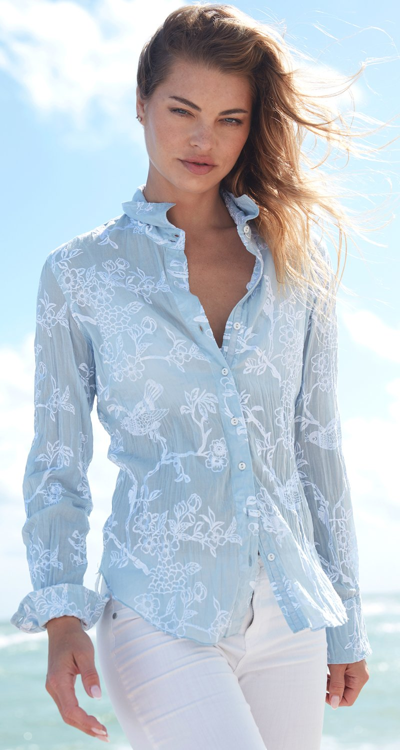 A model wears a CINO Songbird Embroidery LT Chambray/White button down shirt.