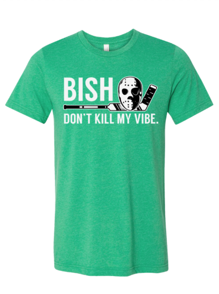 Green shirt that says Bish don't kill my vibe with a hockey stick and hockey mask in Dallas Texas