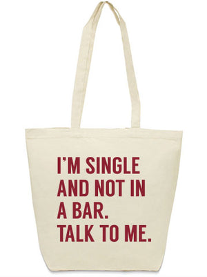 I'm single and not in a bar. Talk to me. Tote bag from Bullzerk in DFW.