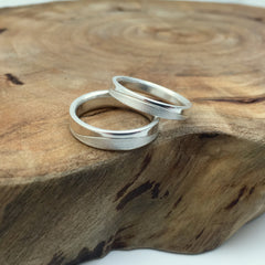 Couple's Matching Silver Bands with Textured Wave