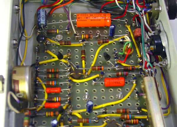 then pcbs came a long and made everything a easier by building all those  wires right into the board