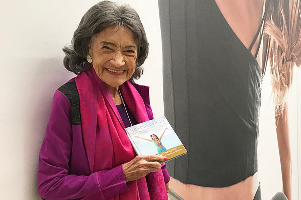 99-year-old yoga master Tao Porchon-Lynch holding her new book, Shining Bright -- November 18, 2017