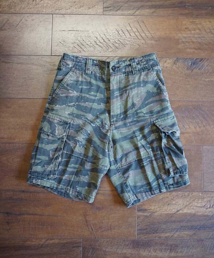 rothco cargo camo shorts on the floor