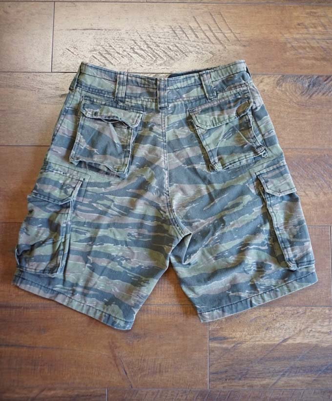 back side of rothco cargo camo shorts on the floor