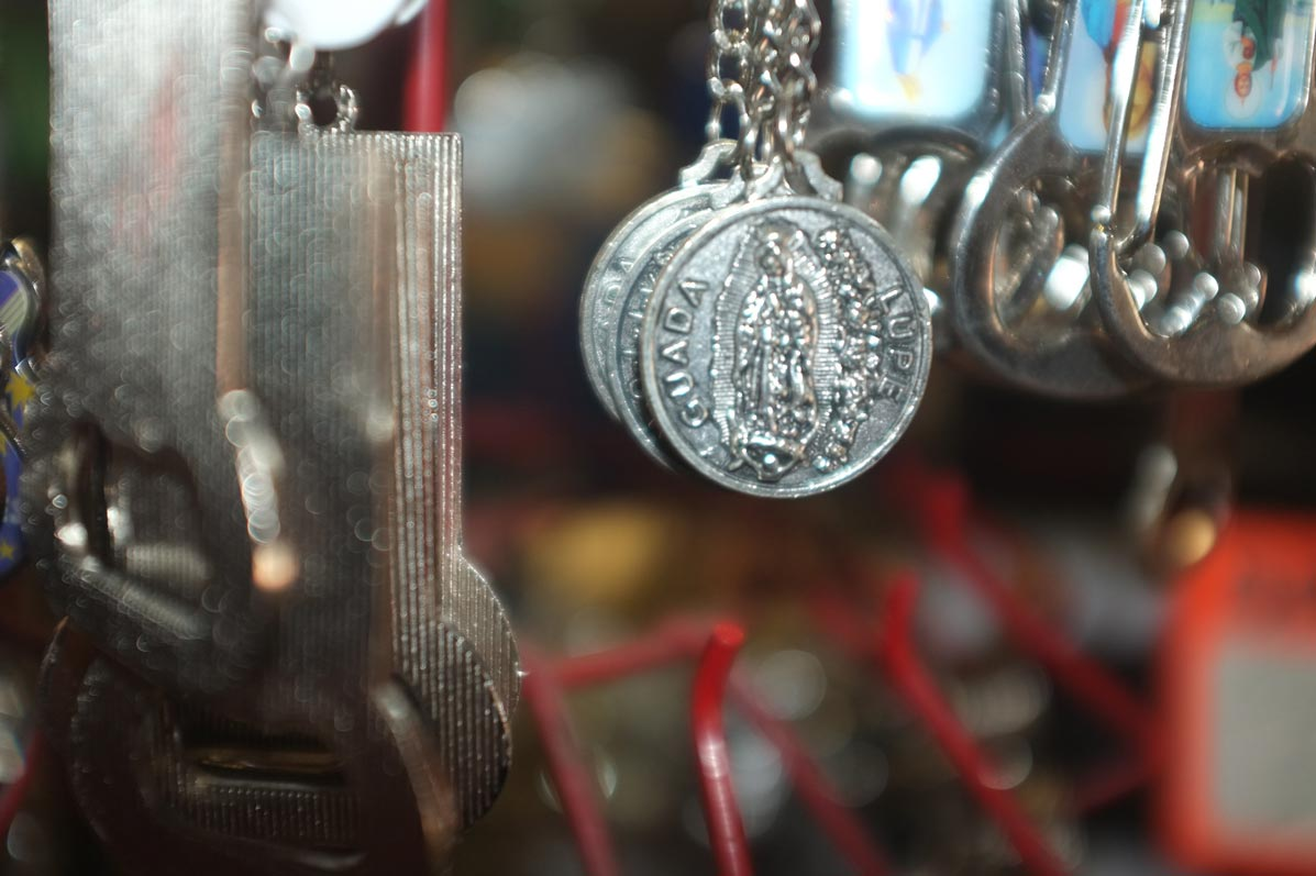 medals-hanging-from-chains-silver-with-blurred-background