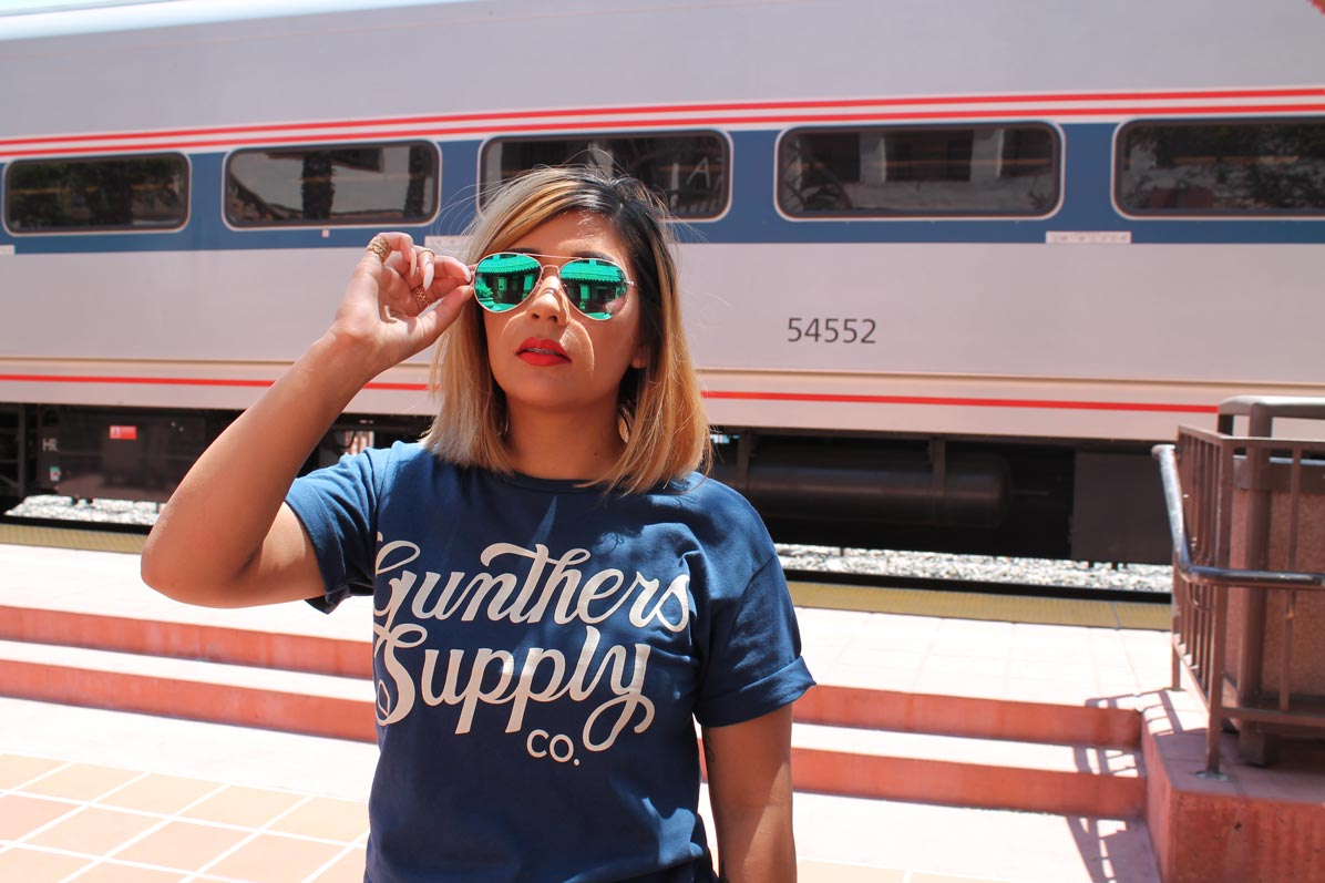 posing-in-front-of-the-train-wearing-gunthers-shirt-and-green-sunglasses