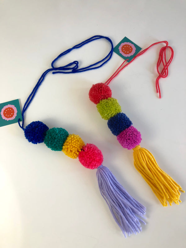 colorful pom bag or doorknob accessory
