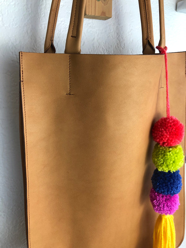 colorful yarn pom bag tag accessory