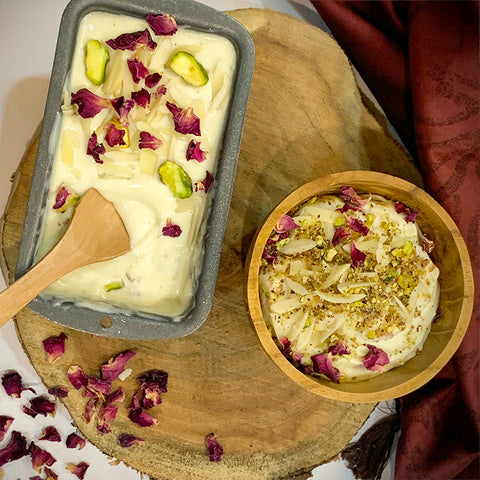 Thandai Ice cream topped with almonds, pistas and edible rose petals.