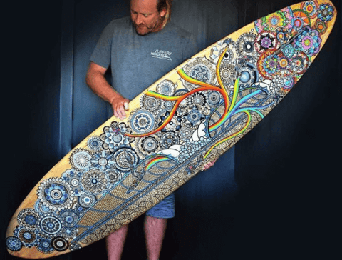 Artist Gareth W. Smith with a surfboard