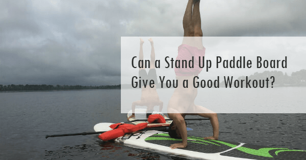 Two men doing SUP workouts